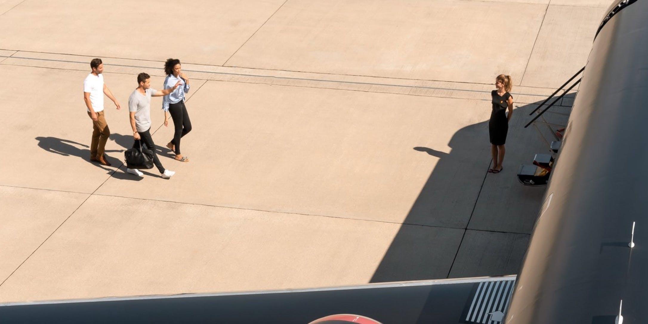 3 passengers boarding the jet