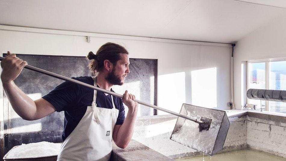 A man working with salt