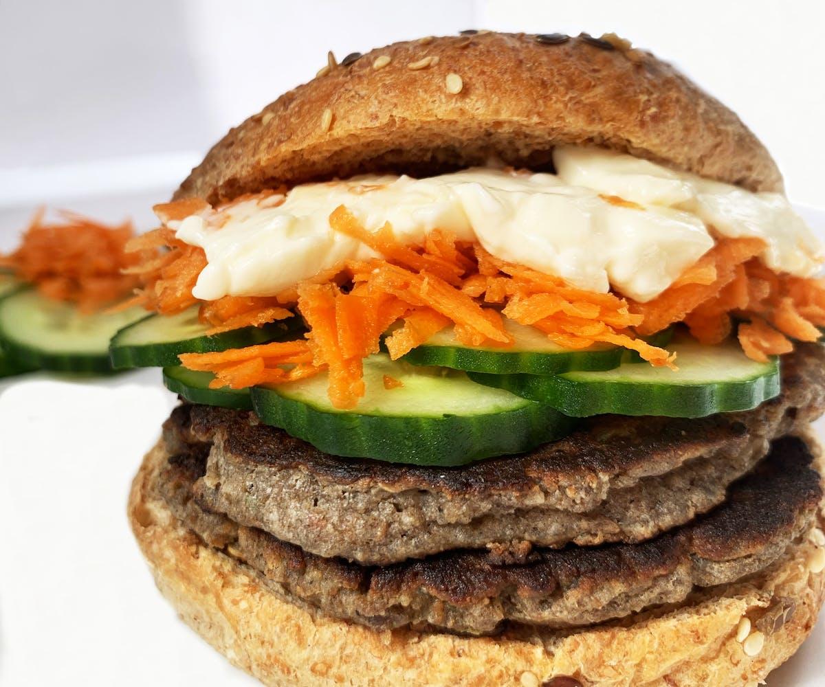 Prepared Cricket Burger patty in a bun