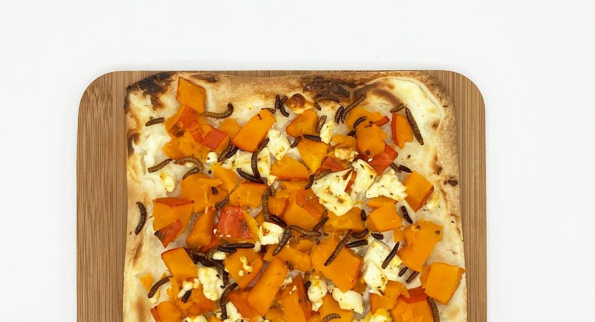 Pumpkin feta flammkuchen with mealworms