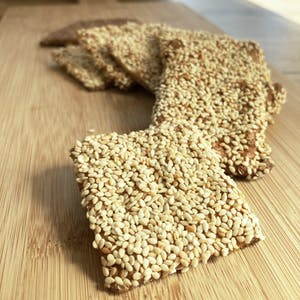 Sesame crackers on wooden board display