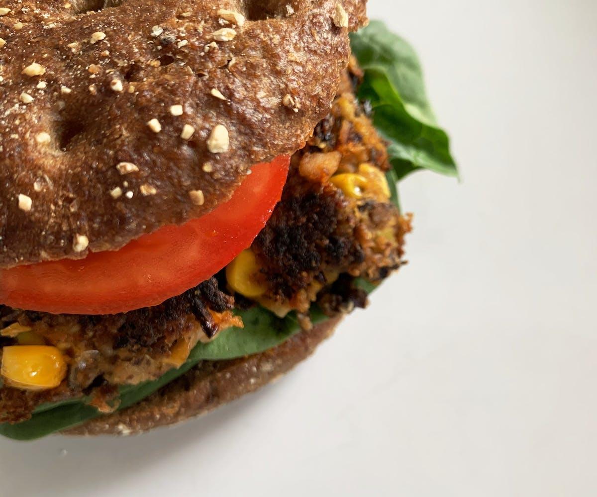 Top view of Buffaloworm Bean Burger in a crispy wholegrain bun