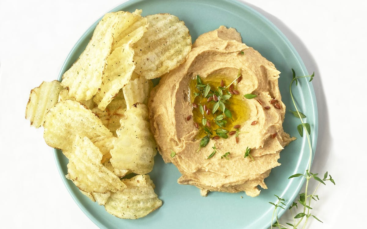 Hummus and crisps on a plate
