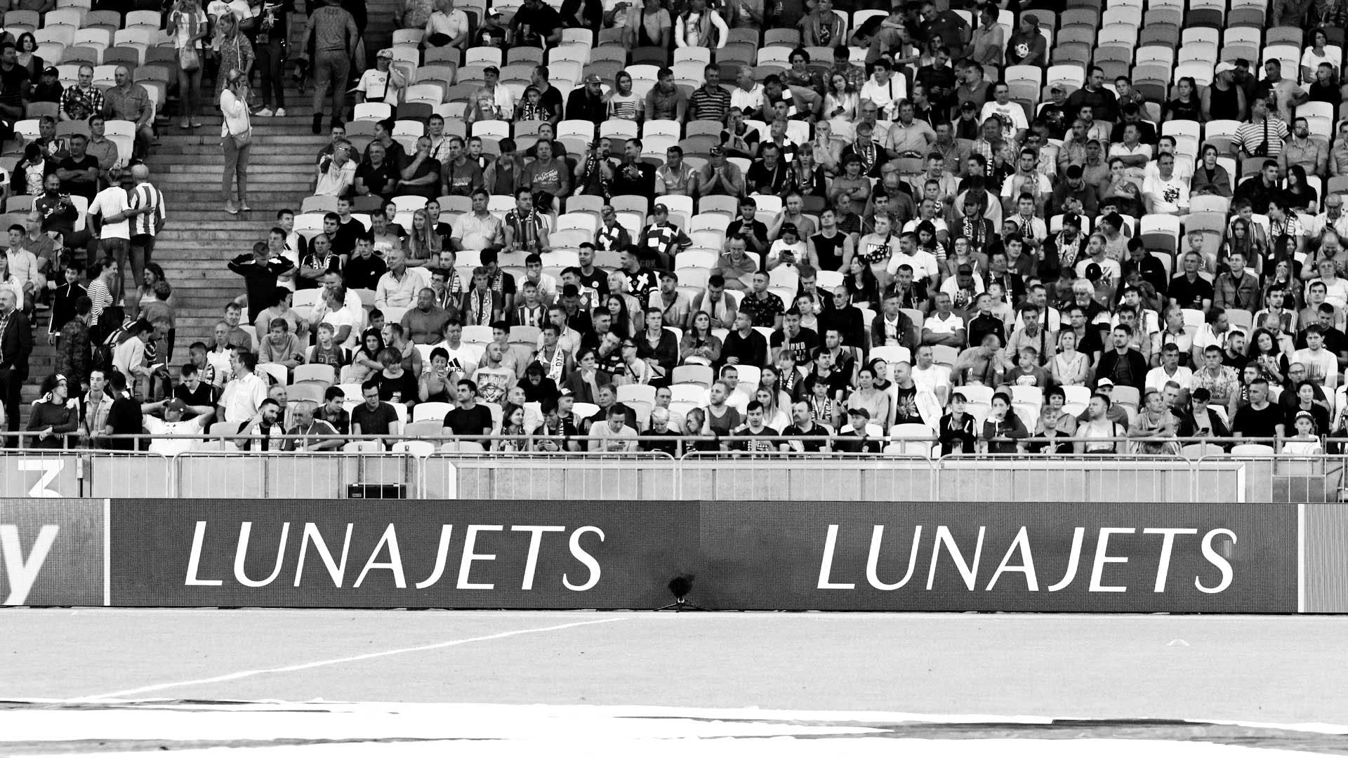 Banner from sponsors in a stadium.