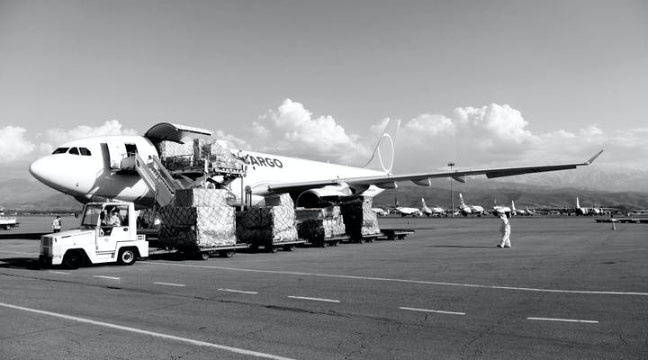 Cargo plane unloading humanitarian cargo