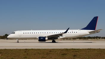 Embraer 190 parked on tarmac
