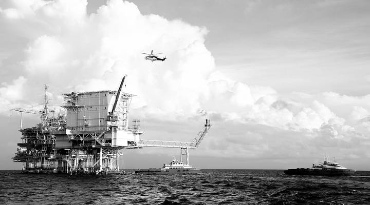Helicopter landing on an off-shore platform for a crew change