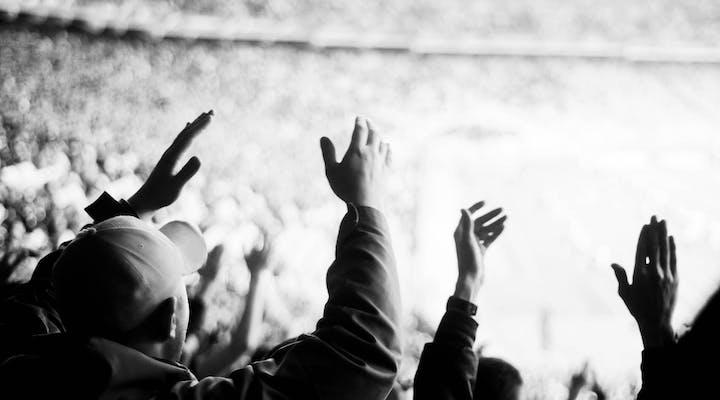 Fans attending a sport game in a stadium