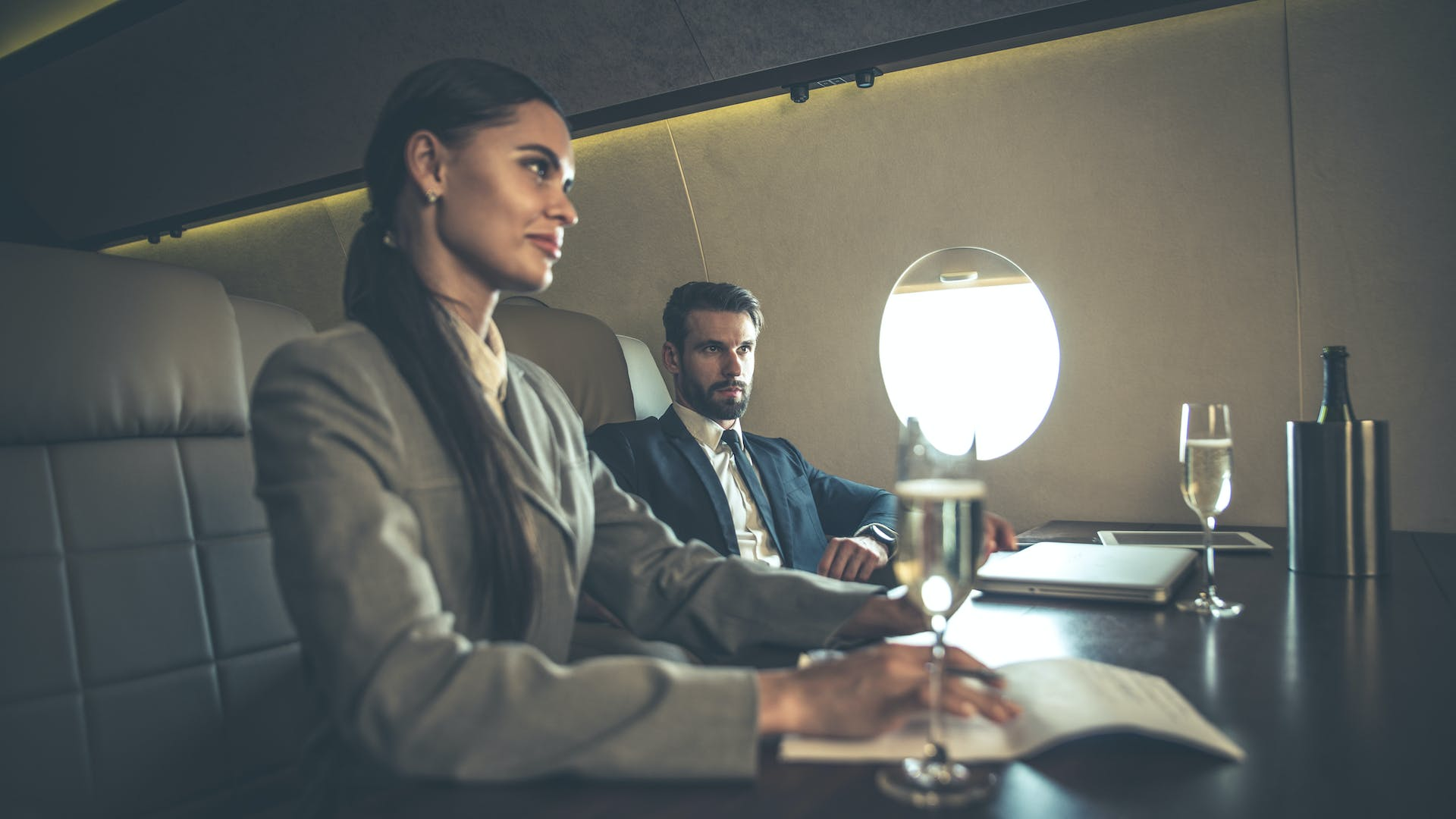 Conduct all matters concerning the government in a flying conference room aboard a private charter plane.