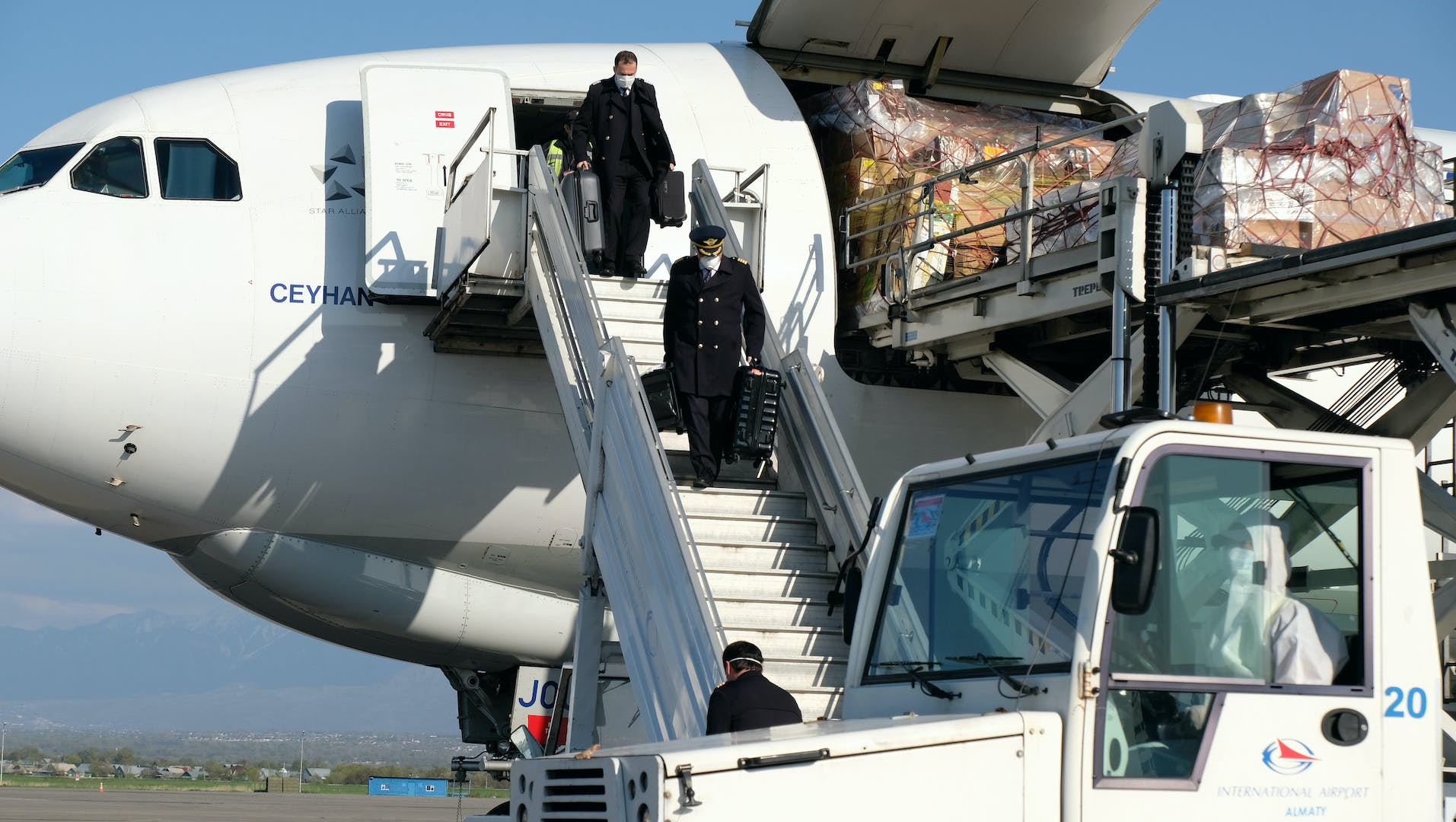 Staff remove humanitarian aid cargo from a privately chartered flight.