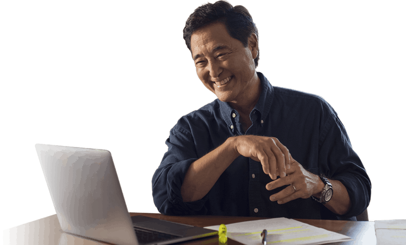 man working and smiling at desk