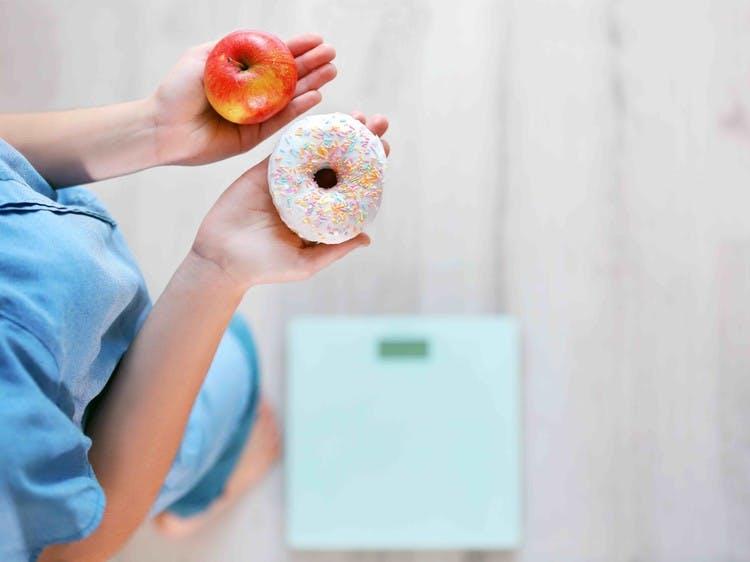 hoeveel calorieen heeft een vrouw nodig om af te vallen