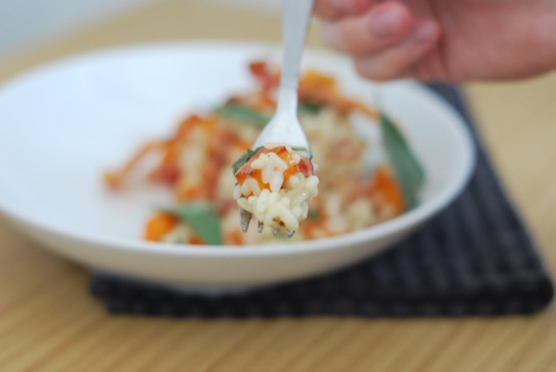 A fork full or risotto, taken face on towards the camera