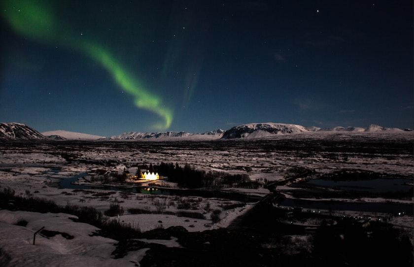 Northern Lights dancing over Þingvellir. Photo by Kym Ellis on Unsplash