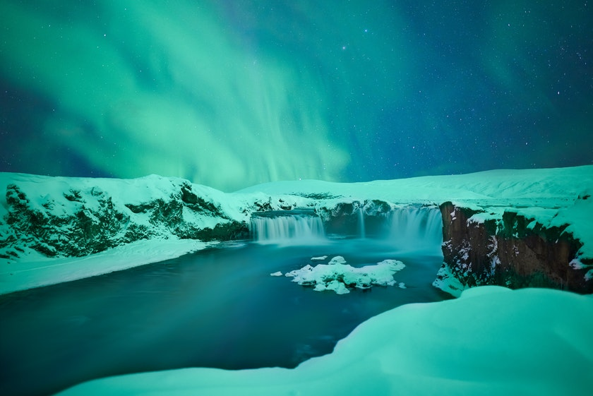 Aurora over Goðafoss. Photo by Marc Marchal on Unsplash