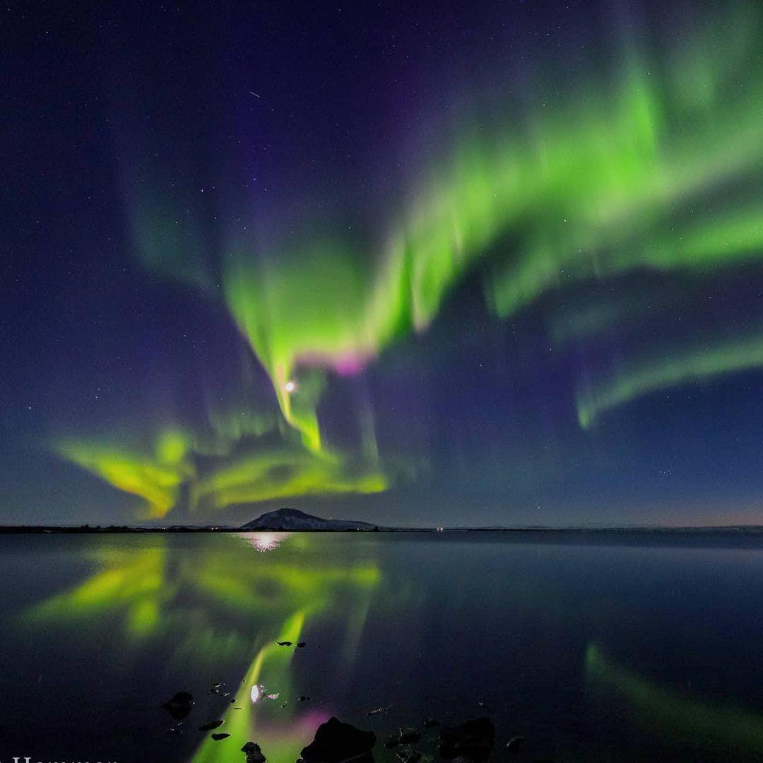 Aurora over ocean in Norway by @hammer_foto