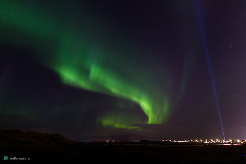 Northern Lights over a city