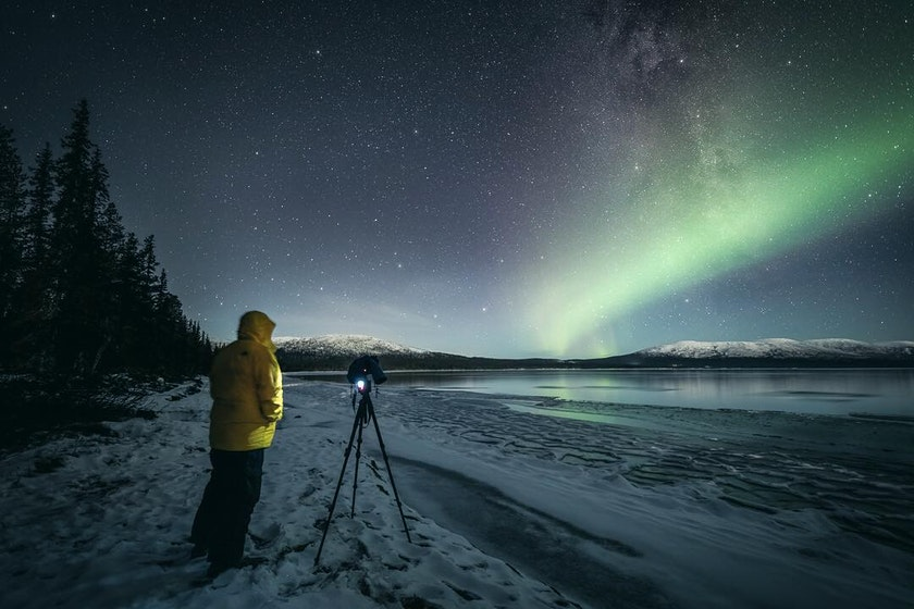 Northern Lights shining over the frozen lake photo by Timo Oksanen