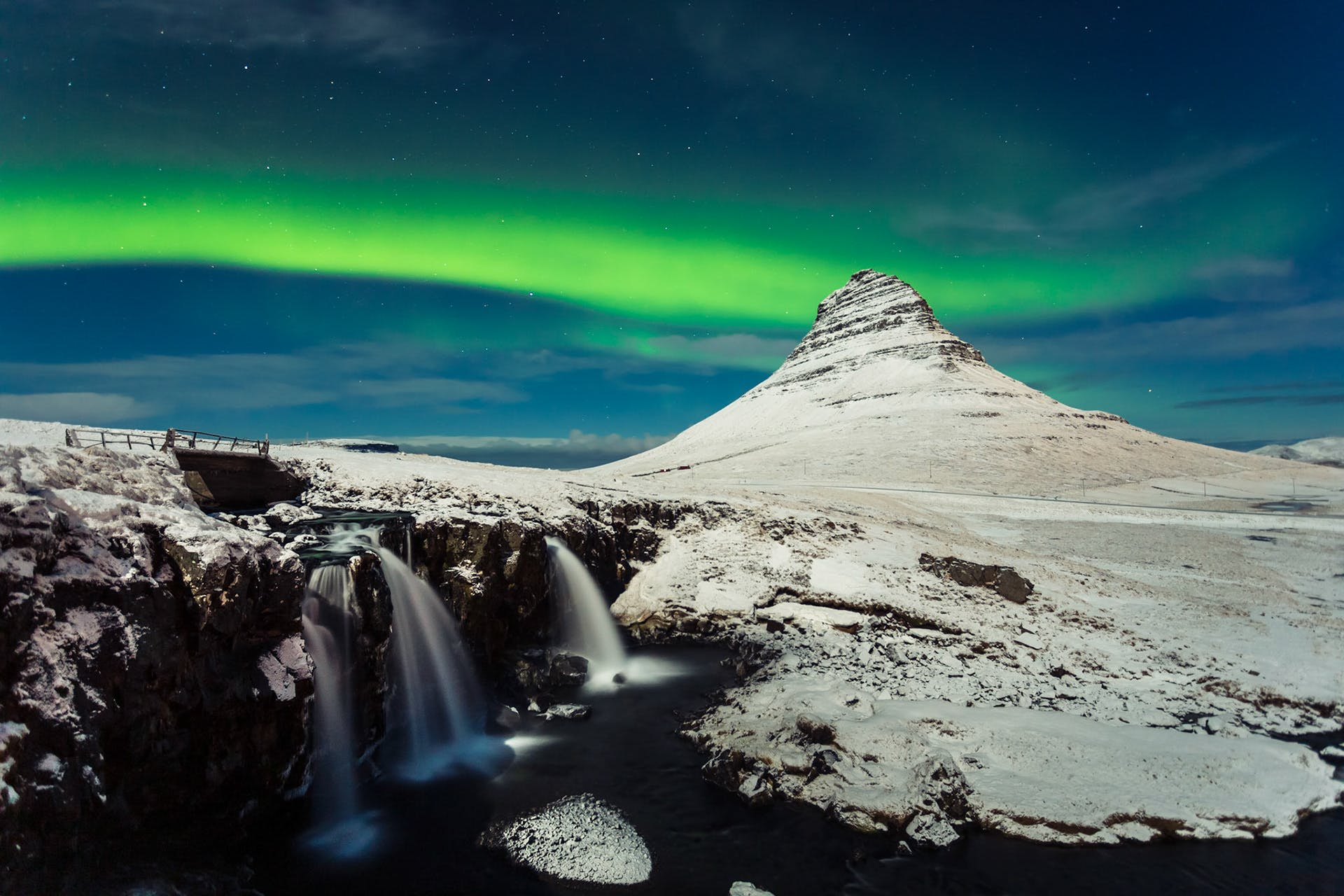 Northern Lights over Kirkjufell at the Snæfellsnes Peninsula in Iceland.