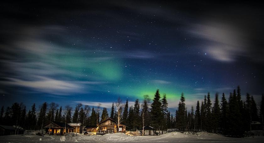 Northern lights in the sky in Kiruna, Sweden. Photo by Timo Horstschaefer on Unsplash
