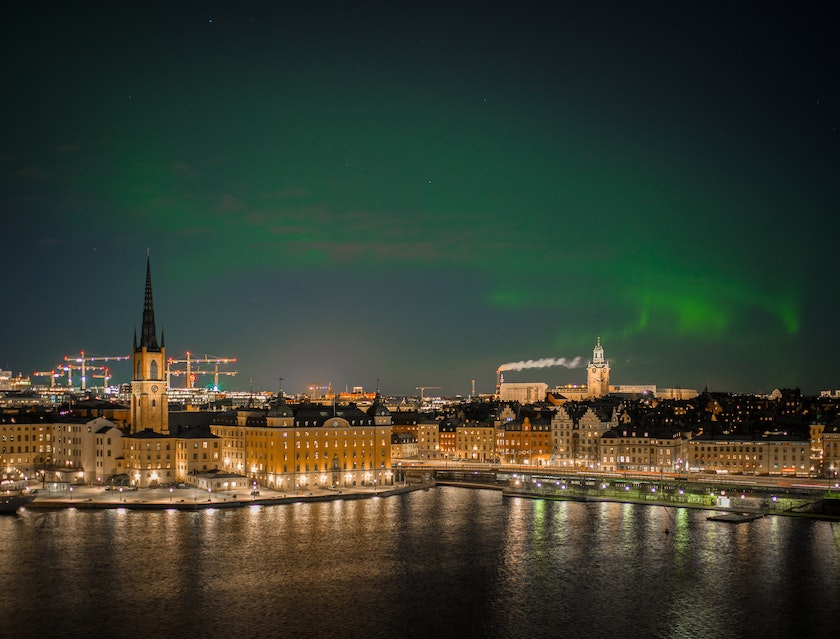 Aurora dancing over Stockholm city. Photo by Micael Widell on Unsplash