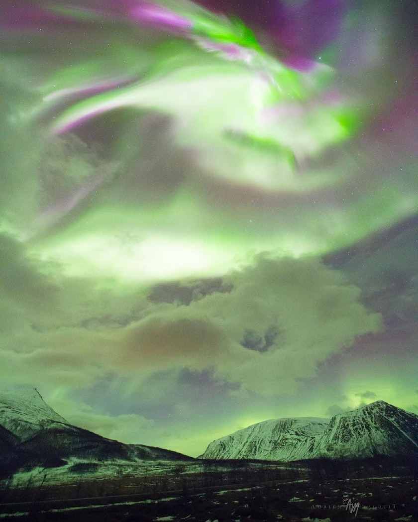 The Northern Lights seeking through the clouds. Photo by @NightLightsFilms
