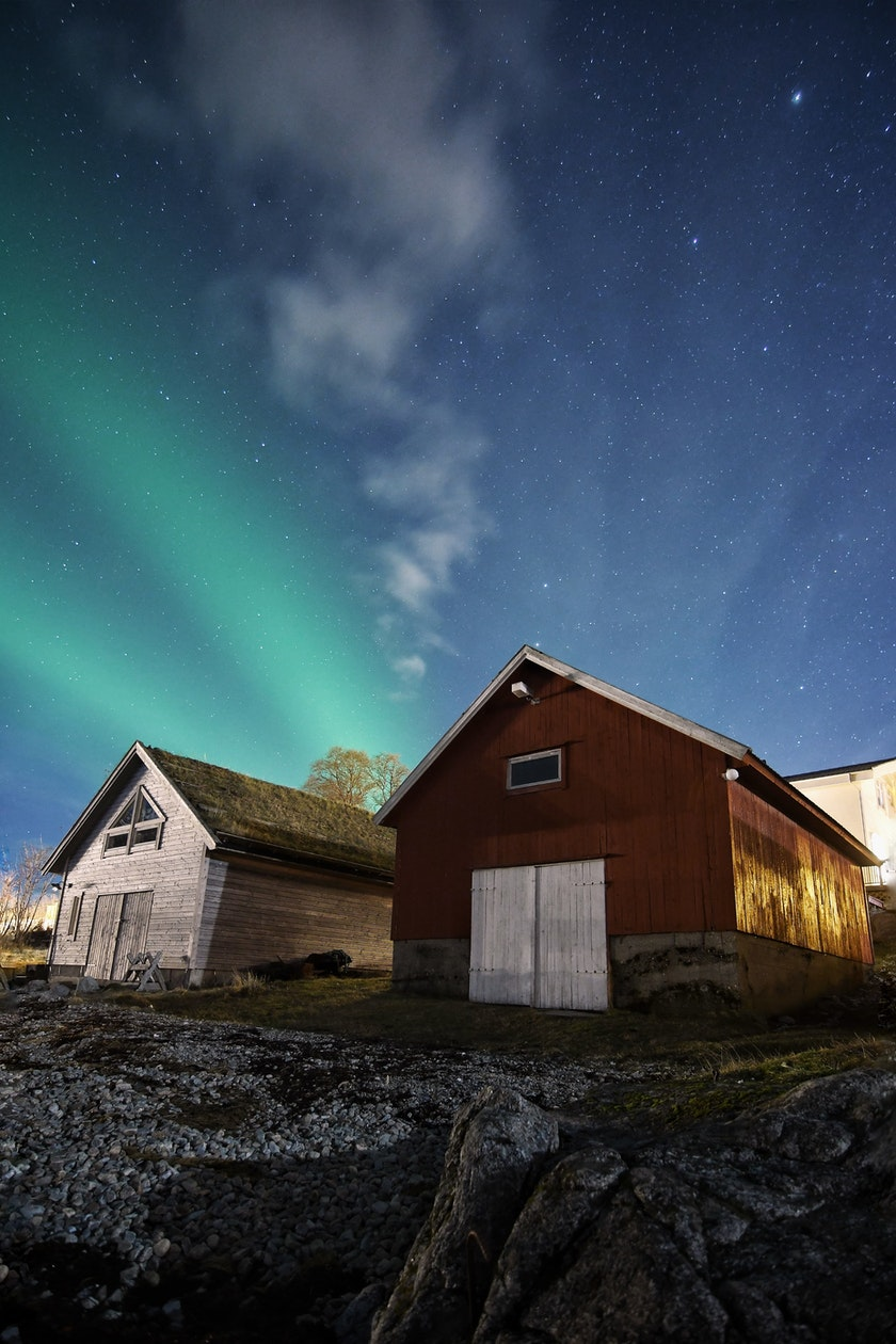 Stunning Northern Lights shining over cottages. Photo by @dancromb, dancromb.co.uk