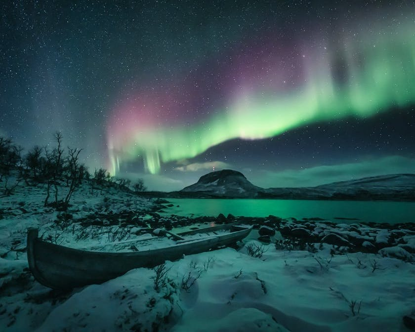 Red aurora dancing over the Fjords, photo by @timoksanen