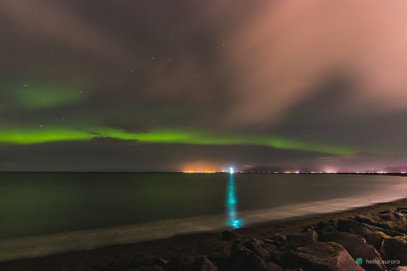 Arc aurora expanding over the ocean