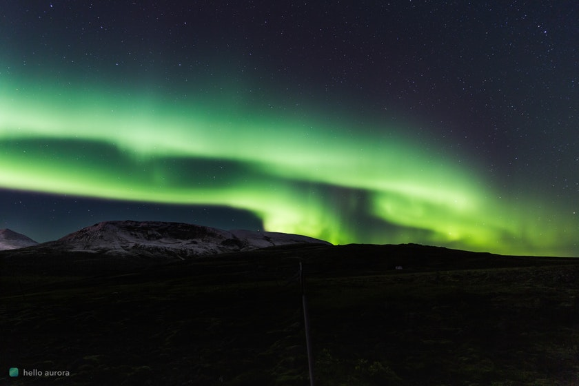 Aurora shaped like an arc stretching over the horizontal