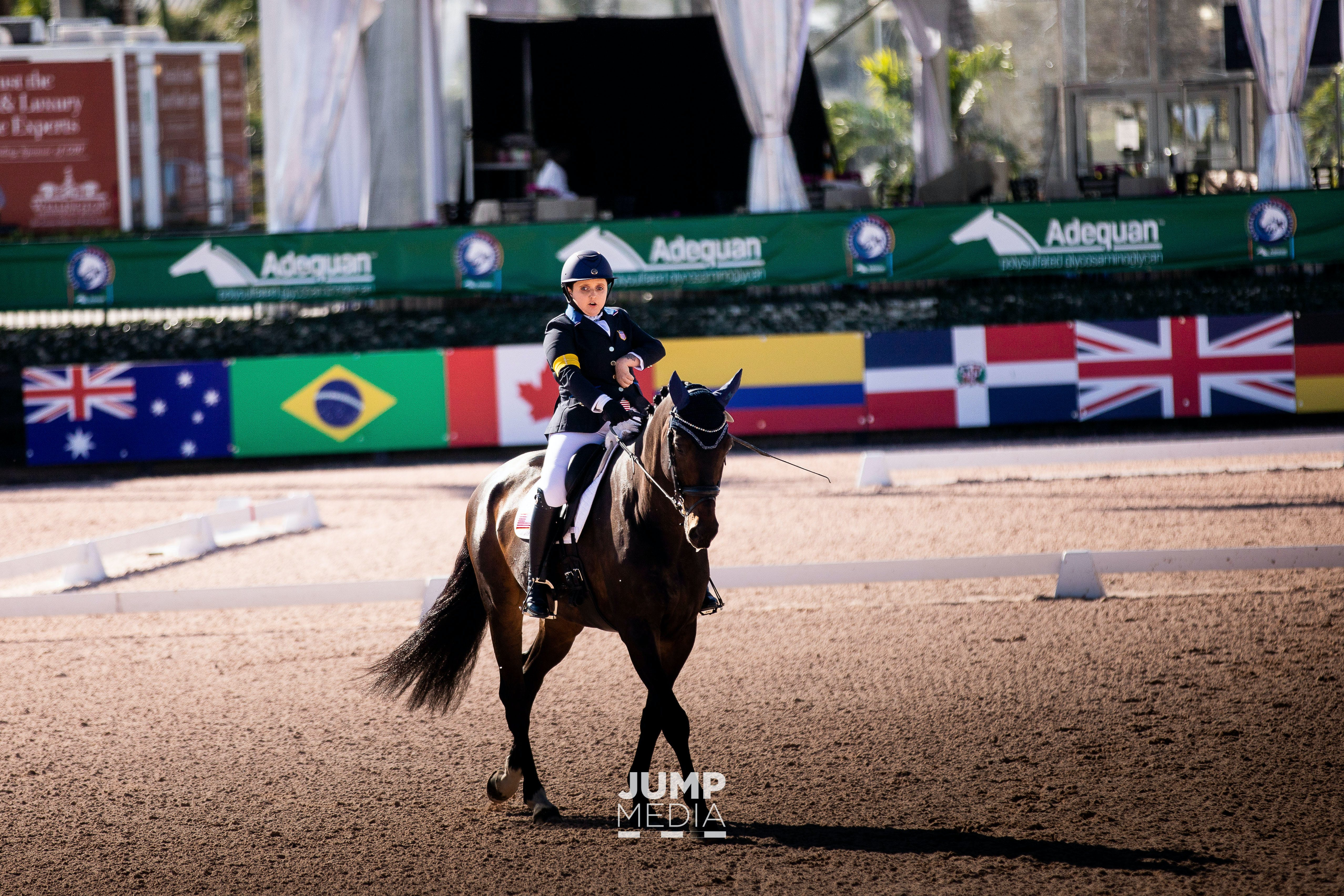 Sydney Collier riding her horse at a para equestrian competition