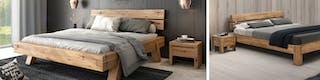 Niedriges Futonbett aus Massivholz mit grauer Bettwäsche vor getäfelter Wand