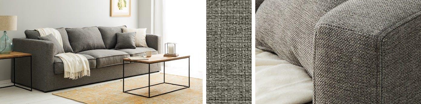 Graues 3-Sitzer Sofa mit drappierter Decke, Kissen und rechteckigem Beistelltisch sowie Detailaufnahme des Kunststofffaserbezugs