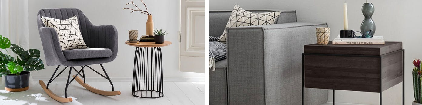 Grauer Sessel und graue Couch mit Kissen in Rautenmuster sowie dunkler Beistelltisch mit schlichtem Dekor