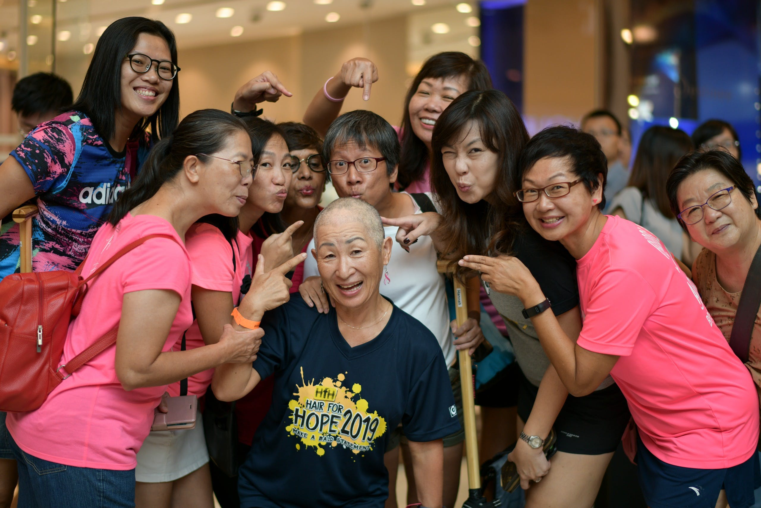 Woman with shaved head for CCF
