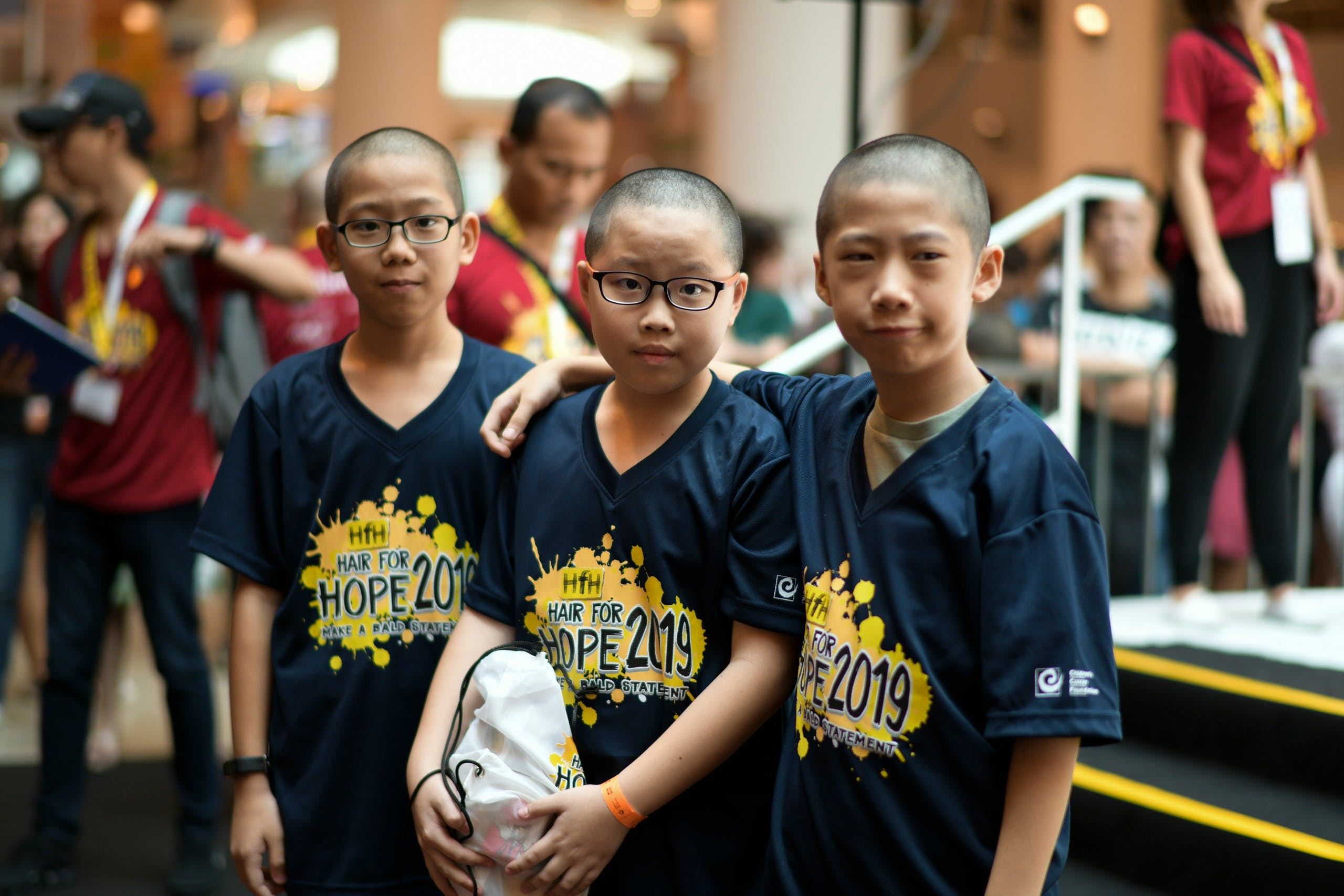 Children with shaved heads for CCF