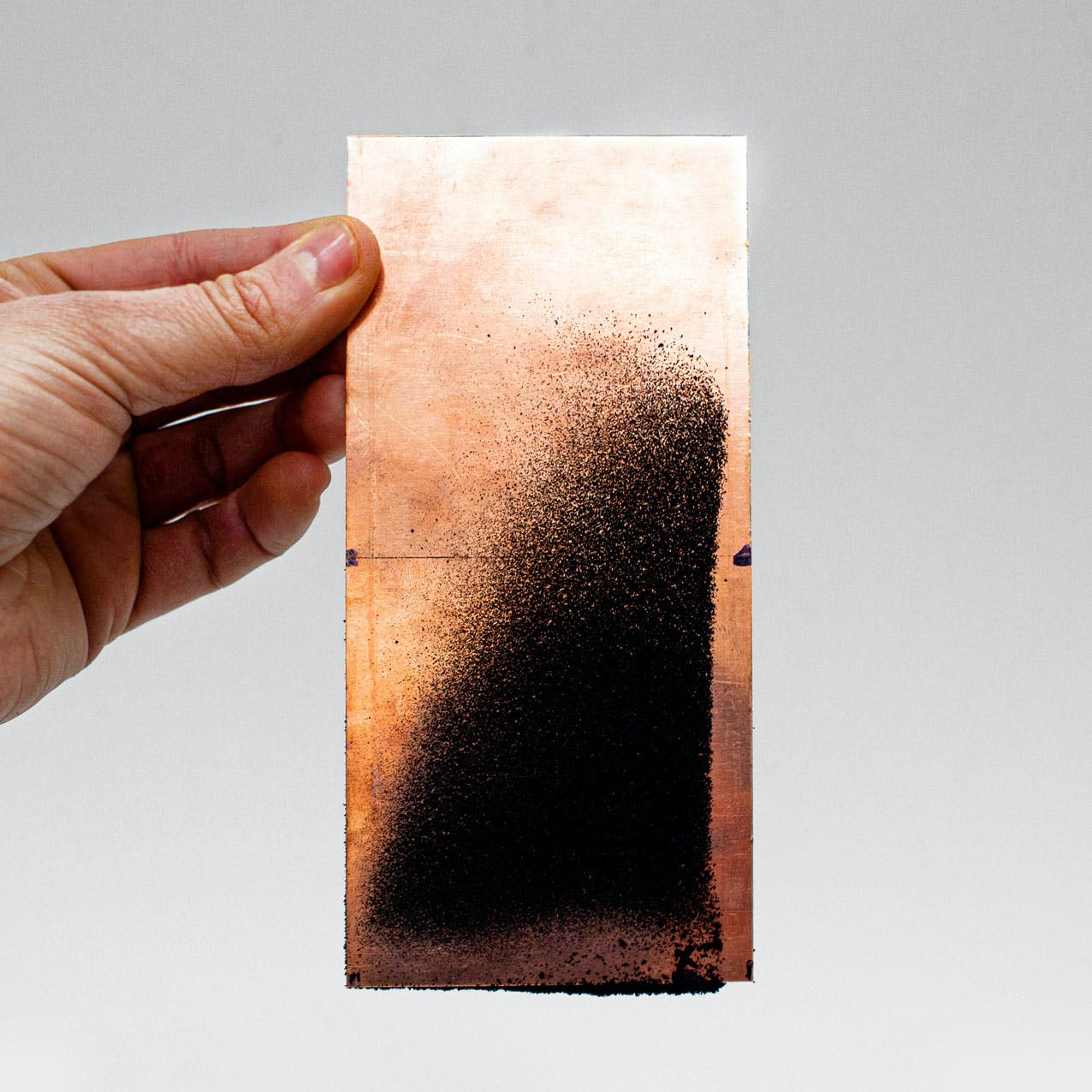 Microplastic Particles on Copper Plate. Source: The Tyre Collective