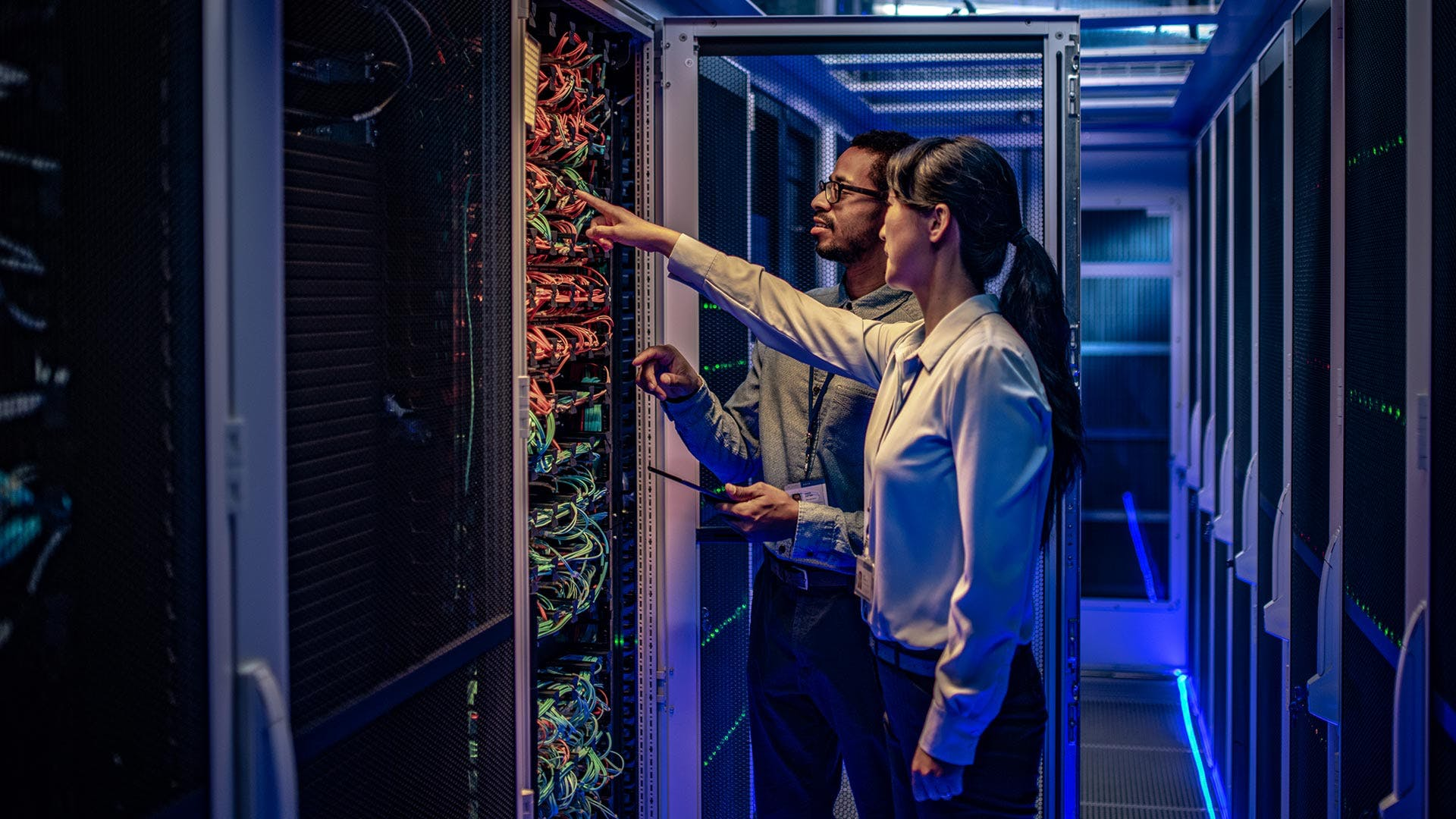 Two IBMers working on a supercomputer