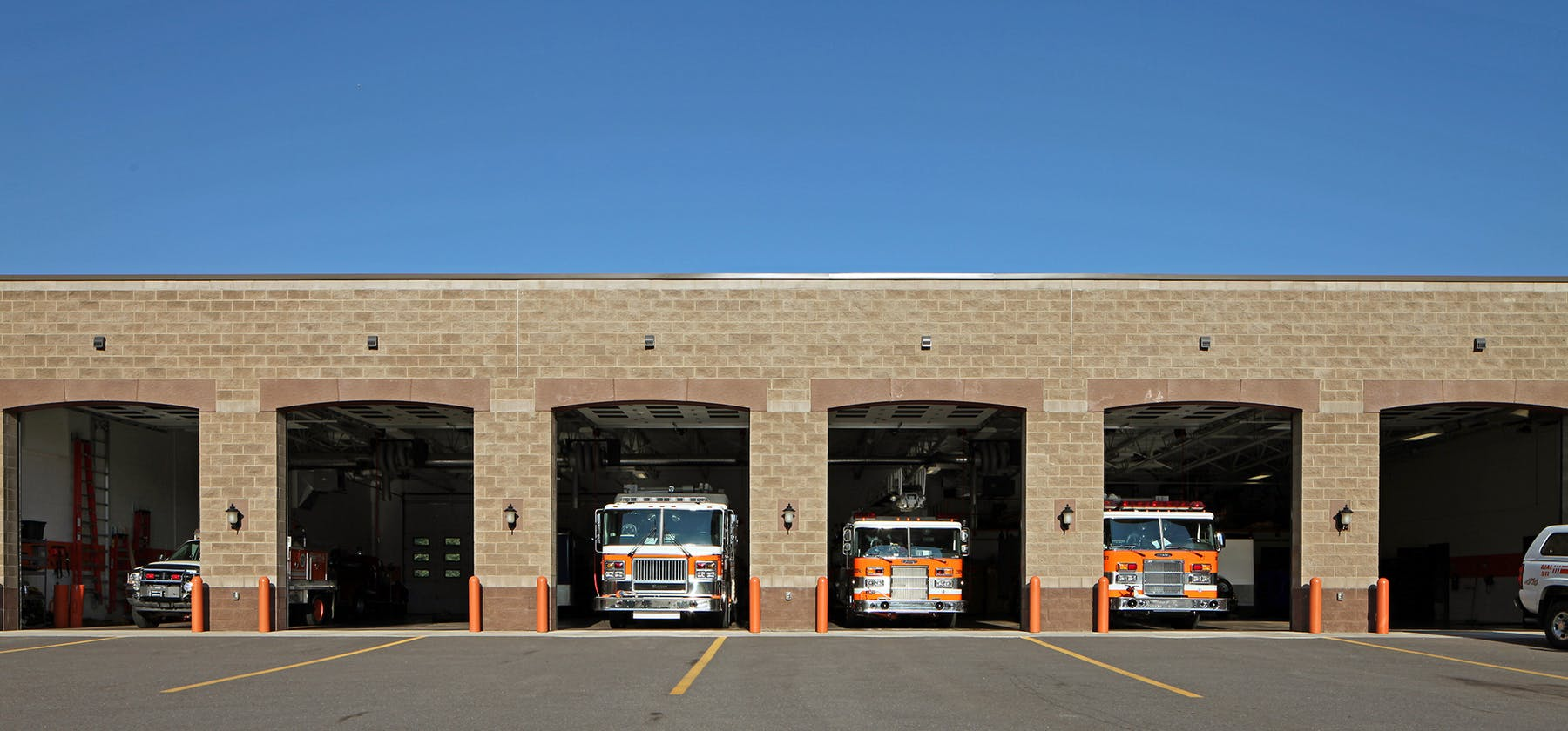 Marquette Township Fire Hall facade with trucks