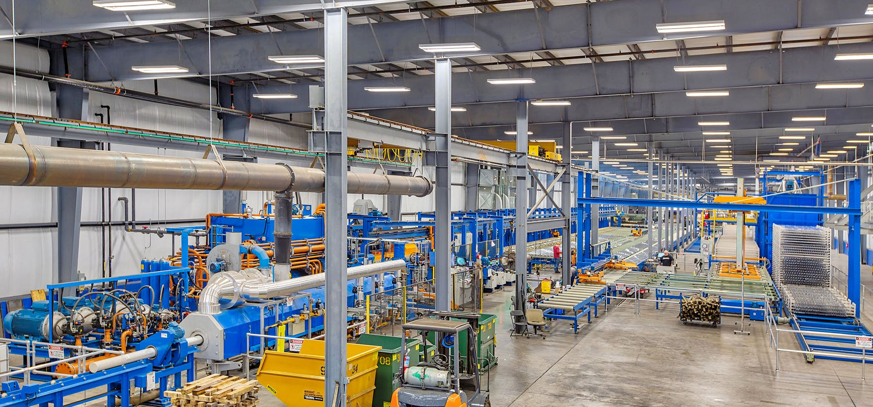 SEI building interior with machinery and forklift