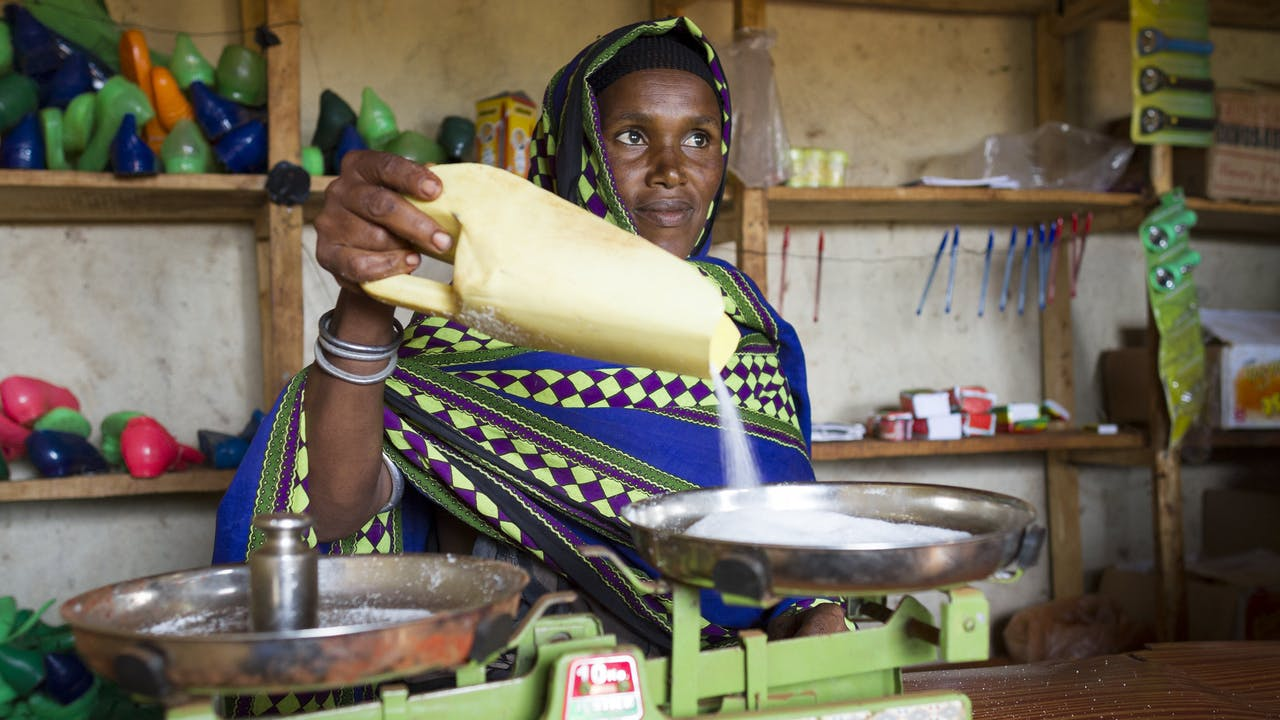 A woman worker looks after her cereal group's small shop in Ethiopia