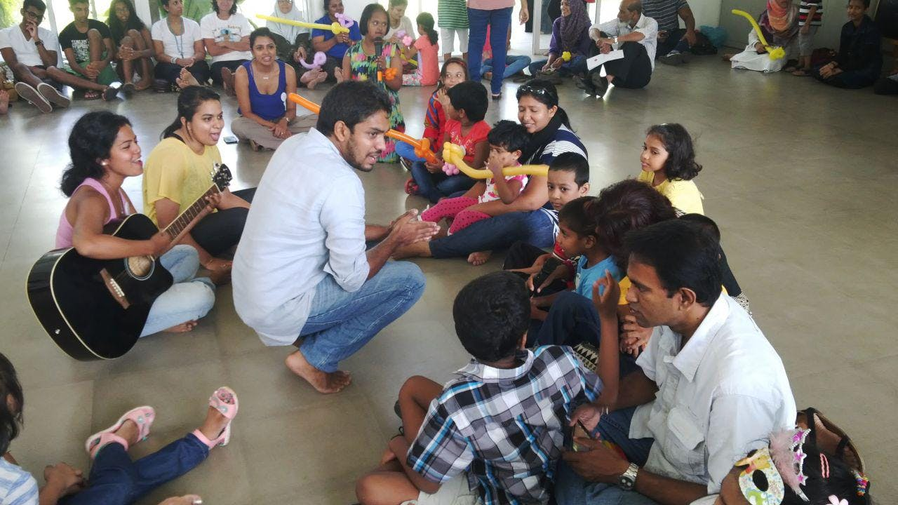 Ridma Weerawardena sings with disabled children in a community workshop.