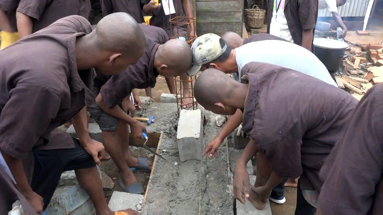 Prisoners at the jail in Antalaha learn to make cinder blocks.