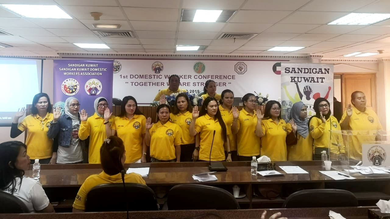 A group photo of domestic workers at the first congress of the Sandigan Kuwait Domestic Workers Association.