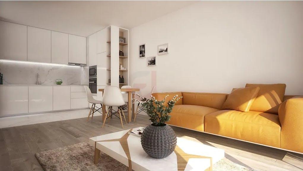 cozinha branca e minimalista em open space num apartamento t1 em viana do castelo