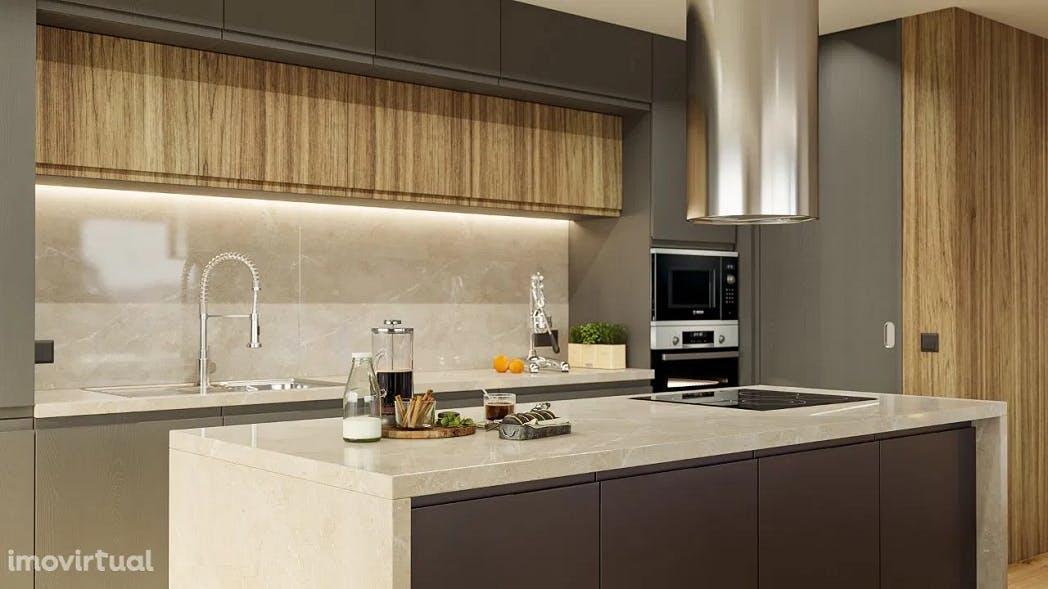 cozinha com ilha em apartamento t3 no canidelo
