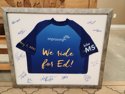 Team jersey, signed by all the riders and support group, presented to Ed Grannan, who the team was riding for.