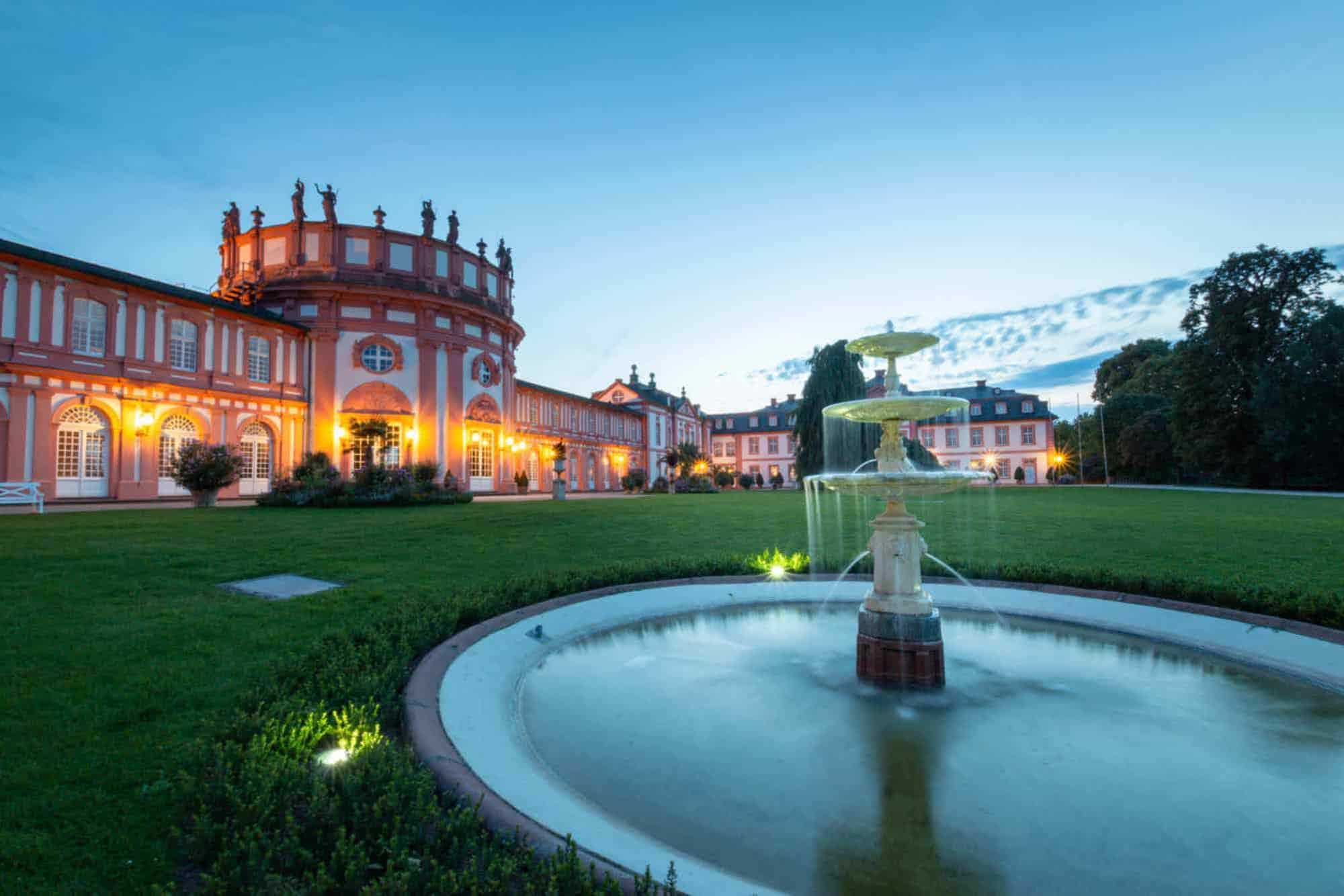 A fountain and a beautiful building are part of your South West Germany Road Trip