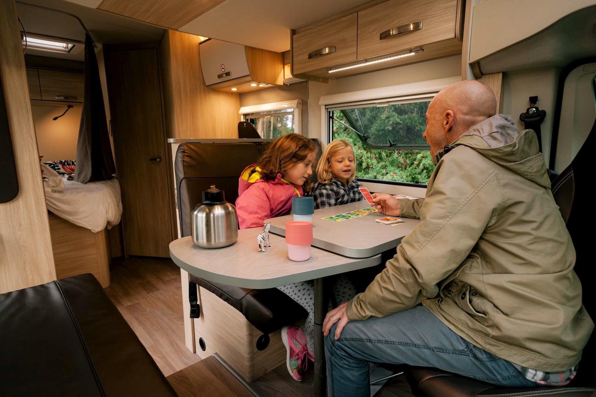 Family playing inside the Atlas Model
