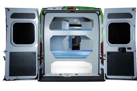 Indie Campers' campervan seen from behind with doors open